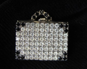 Vintage rhinestone and silver photo album brooch by Dorothy Bauer