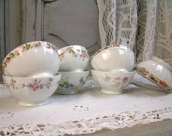 Set of 7 french vintage bowls. French vintage porcelain bowls with flowers. French cafe au lait bowls. French coffee bowl. Footed bowls