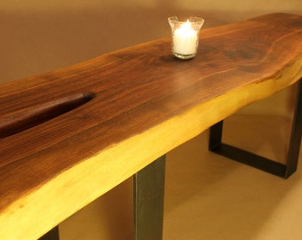 Siemore......Live Edge Walnut slab table with Bowtie inlay.