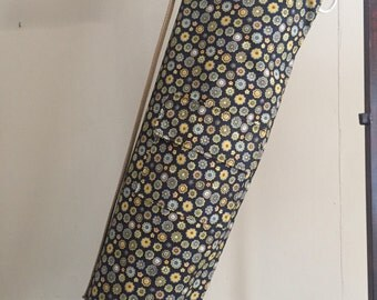 Yoga Mat Bag with pocket and drawstring close fits all mats.  Navy background with earthy toned flowers