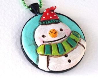 Original Snowman Folk Art Necklace with Red Hat in Round Black Bezel setting
