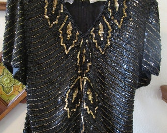 GorgeousBlack and Gold Sequined Woman's  Top