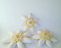 3 handbuilt ceramic wall flowers sold together. Approximately 5.5 to 7.5 inches across.