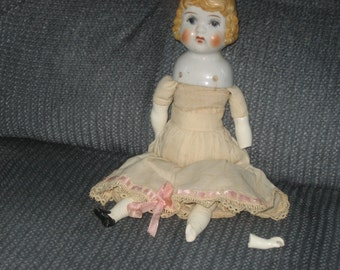 """Antique china doll with blond hair - 10"""" tall"""