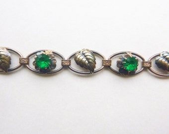 Art Nouveau gold filled two tone sectional bracelet with green paste stones and leaves