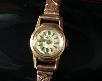 MUDU 18ct gold watch on excalibur bracelet