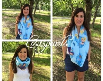 Cinderella Infinity fleece scarf. Beautiful shades of blues and nice pictures . One size fits most .