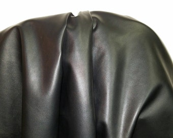 Black Faux leather Pleather sold by the yard 36 inches x 52 inches wide Synthetic for one yard.  1 yard- 5 yards