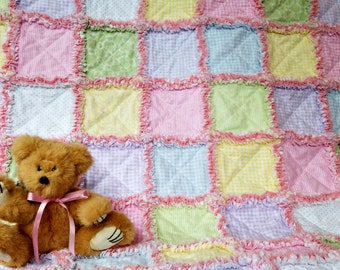 Pink, green, yellow, blue and lavendar flannel rag quilt for baby girl