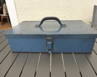 Case in blue metal, vintage kit has tools , Interior beige carpet , industrial decoration