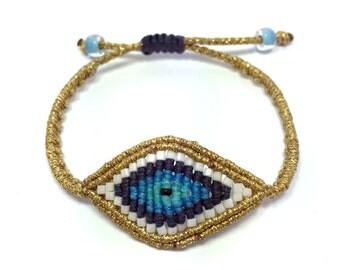 Gold and denim blue beaded eye bracelet