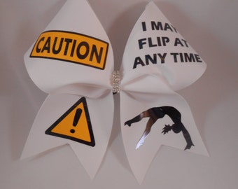 Cheer Bow CAUTION I May Flip At Any Time w/ rhinestone center White grosgrain by BlingItOnCheerBowz