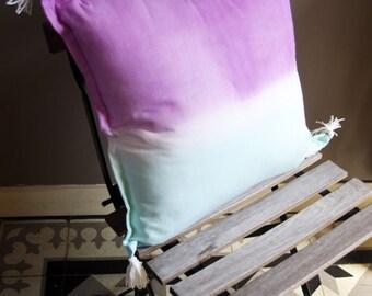 Turquoise and mauve cushion