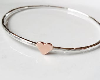 Sterling silver bangle with hand pierced copper heart, made to order.