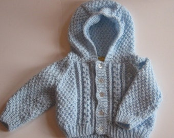 "Blue hooded sweater.  Measures 20""(50cms)around chest. To fit approx 3-6 months . Baby boy jacket. Aran style hoodie."