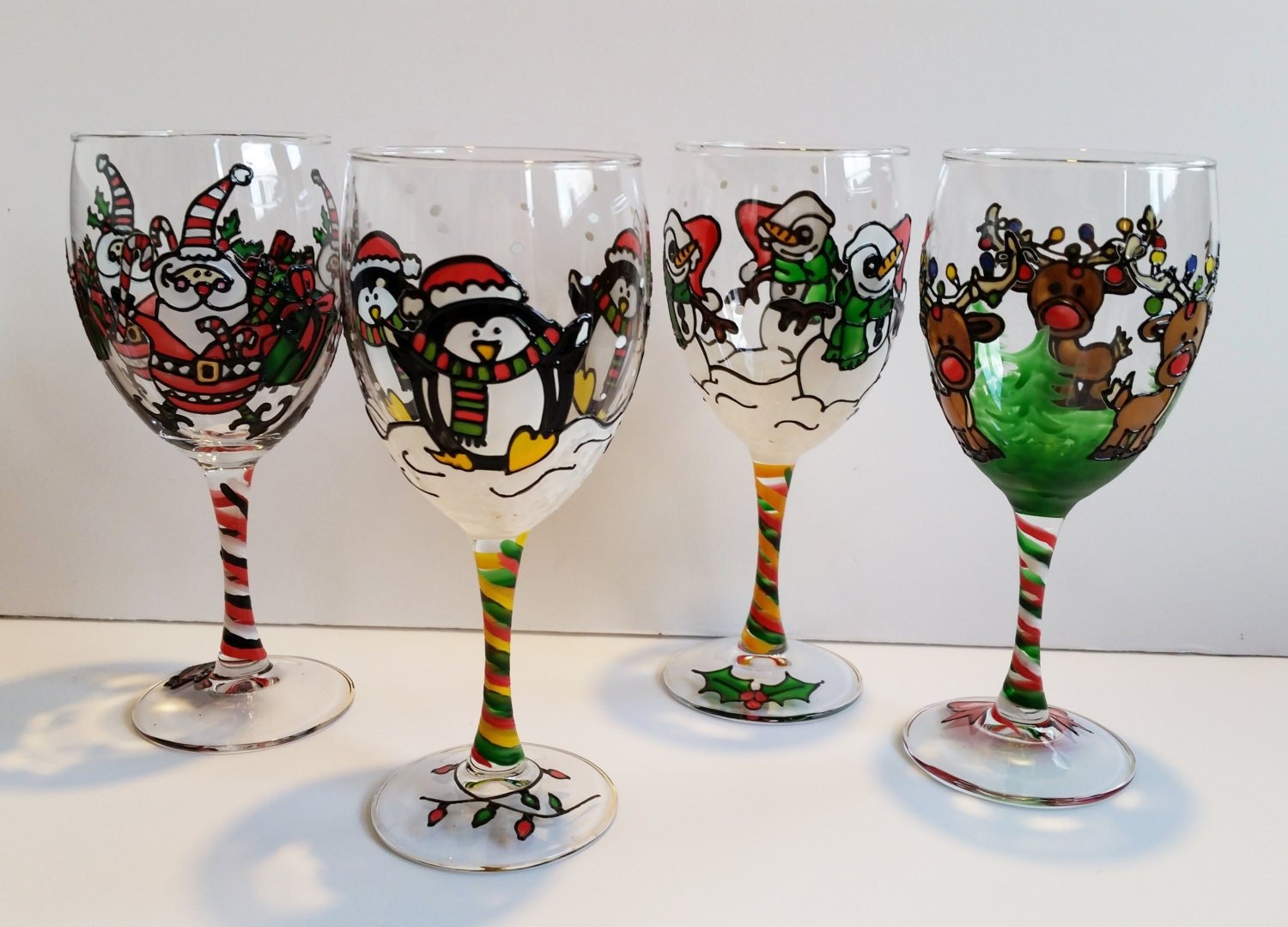 Wine glasses hand painted christmas wine glasses set of for Hand painted wine glass christmas designs