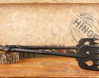 Vintage Cast Iron Fork Tongs with decorative heart/spade pattern.  Item737s