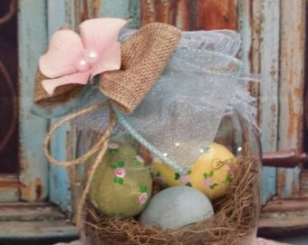 Hand painted easter eggs in decorated vase. Easter centerpiece, hand painted easter eggs, speckled eggs, easter decoration
