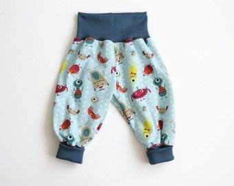 Baby harem pants. Green bubble pants with little monsters and dots. Comfy slouchy infant pants with petrol fold over waistband and cuffs.