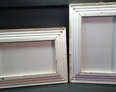 Two reclaimed rustic chipped-paint wood frames custom cut