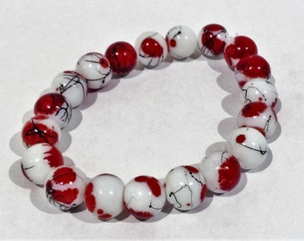 Bracelet.19cm Features High Quality Enamelled Round Glass. White. Red splash patterns. Veined  patterns also
