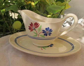 Faience Luneville gravy boat and saucer - model may