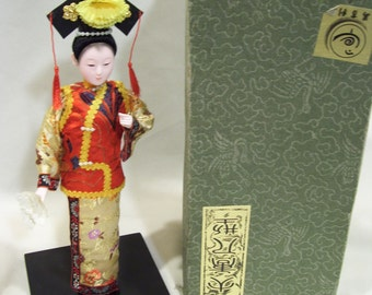 Asian Geisha Doll with Base and Original Box, Red,Gold and Black, Lacquered Base