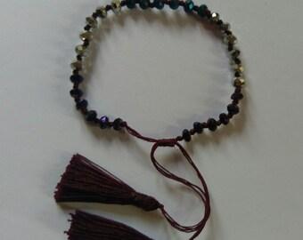 Handmade crystal bead with tassle bracelet.