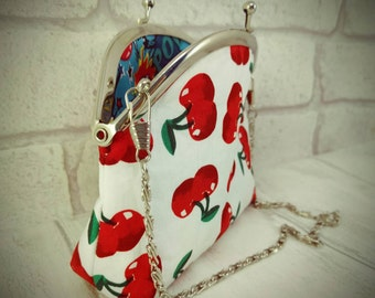 Retro purse with red cherries and blue superhero smash pow fabric, kiss lock, silver snap frame, alternative wedding purse, gift for her