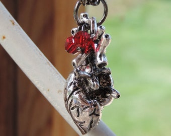 The Beating of the Hideous Heart - Pewter heart with Swarovski crystals