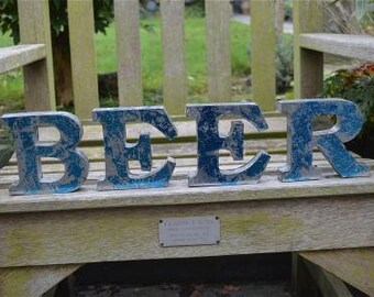 Fantastic 3 dimensional retro metal blue letters 'BEER' sign font