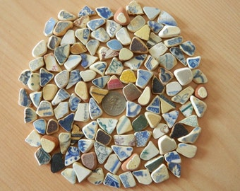 125 Tiny pottery shards in assorted colours for crafts