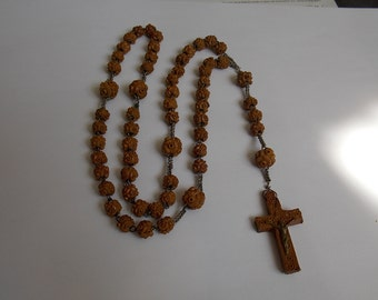 old wood carvings and silver beads Rosary