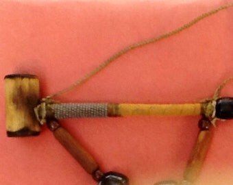 Medicine or Peace Pipe. Tribal Design. Hand crafted. Wrapped stem. Beads. Hanger. Feathers. Distinctive. Collectible