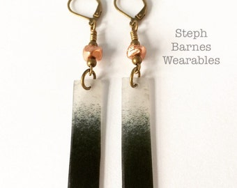 hand painted earrings in black with cast copper detail