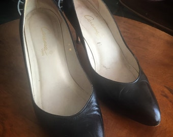 Black leather pumps made by Caressa size 6m