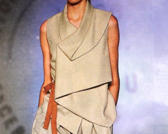 Beige vest-top with folded collar and hem