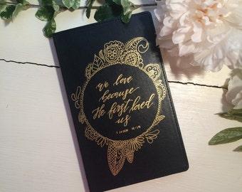 1 John 4:19 Hardcover notebook