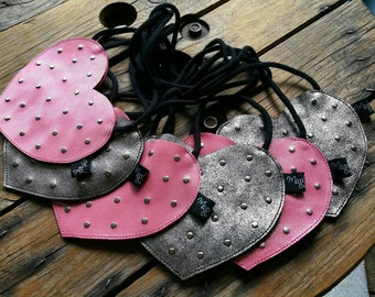 Bag heart shaped Valentine. Girl in leather pouch