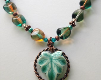 Fall/ Autumn necklace with artisan ceramic leaf focal with beads of teals, rootbeer, copper w copper chain & toggle, 24""
