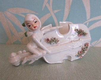 1950s Lefton-style ceramic cello planter with pixie and flower detail, lustreware