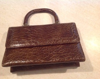 Stylish 1950's-60's croc embossed, brown with brass details Kadin handbag. Made in the USA.