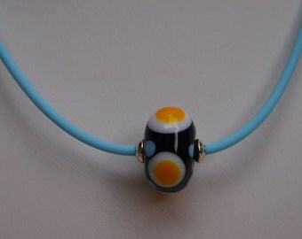 Necklace in Lampwork Crystal, Blue Rubber Cord and Sterling Silver