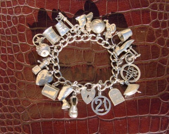 Vintage hallmarked English sterling silver charm bracelet 1960's charms silver sterling