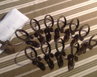 Sublime antique French cast bronze curtain napkin rings