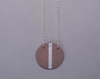 geometric black clay ceramic handmade circle disc minimal necklace with silver band
