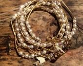 Crystal Pearly Bracelet Set with gold plated charms - Pulseras Semanario Combinacion perlas con cristal con dijes de chapa de oro