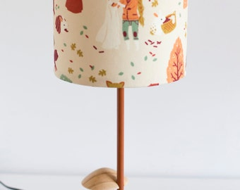 Woodland nursery natural wooden toadstool lamp with rustic woodland girl barrel lamp shade in autumn colours