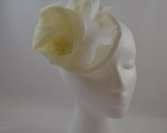 White fascinator on sinamay disk