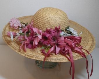 Wide brim straw hat with  flowers